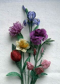 Wired and beaded flowers. These would be pretty as a medallion or on a bib necklace