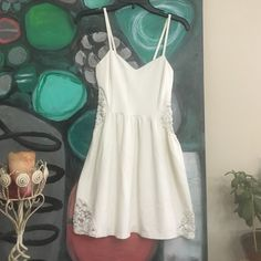 Spaghetti strap white dress! Sexy, with Lacey cut outs on the side and bottom of dress. This is like new and size small. Bear dance  Dresses Midi