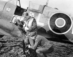 "S/L Stanisław Łapka of No 302 Squadron RAF is helped into his harness moments before climbing into Spitfire Mk Vb WX-L to stage a publicity flyover at RAF Kirton-in-Lindsey in March 1943. The aircraft was the personal mount of S/L Julian ""Roch"" Kowalski, coded L for Leader in accordance with the unit's tradition until 25 August 1942, when command was passed to his fellow Polish successor."