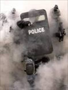 Riot shield used to protect from projectiles such as bullets or thrown objects