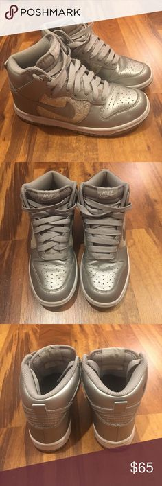 Women's size 6 Nike shoes Silver women's Nike shoes with sequins on the sides. Women's size 6; High tops; gently worn Nike Shoes Athletic Shoes