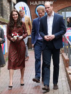 Kate Middleton Photos Photos - Catherine, Duchess of Cambridge and Prince William, Duke of Cambridge with Prince Harry attend a Christmas party for volunteers at The Mix youth service on December 19, 2016 in London, England. The Mix youth service works with Their Royal Highnesses' Heads Together Campaign. - The Duke And Duchess Of Cambridge