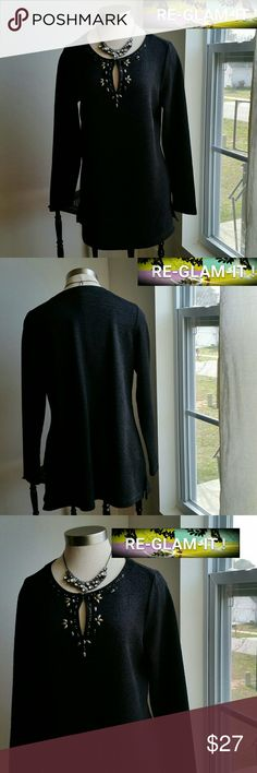 DANA BUCHMAN.. NEW LISTING..BEAUTIFUL BLOUSE ..ADDING INFO SOON..EXCELLENT CONDITION  ..NORMAL WEAR...NO FLAWS  ..SIZE TAG M...BUT FITS MORE LIKE A LARGE ..DESIGN ON FRONT  ..LONG TUNIC ..STYLE  ..KEY HOLE FRONT ...AS SHOWN 4 PIC. ..PERFECT WITH SKINNY JEANS OR TIGHTS  ..A MUST HAVEEEEE... Dana Buchman Tops Blouses