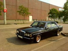 Beautiful old Mercedes W123 on BBS wheels. The black and gold color scheme feels very period correct