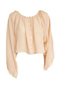 This cropped blouse fits right in with lazy day dressing.