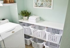 Textures and colors of this laundry room...also the laundry basket organizational system