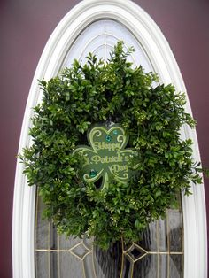 St. Patrick's Day DIY Wreath . . .    Replace Sign With Pretty Celtic Cross; Add Some Pale Yellow, White & Brown.