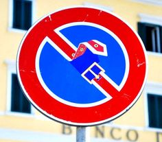 French authorities say he's a vandal, but artist Clet Abraham prowls the streets of Europe to add his own irreverent twist to traffic signs. A friend gives him a boost and he slaps a sticker in place.