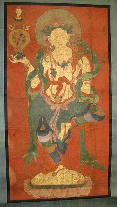 Dancing dakini perhaps  a perfected female deity holds the Buddhist wheel of wisdom -dharmachakra- in her right hand, flanked by golden fish and surmounted by a conch, symbols of auspiciousness. On paper from a larger sheet  (now lost). 18th C. Tibet