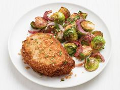 Get Crispy Pork Chops with Sriracha Brussels Sprouts Recipe from Food Network