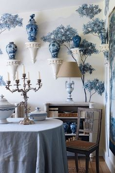 all of the blue & white. love the sconces + ginger jars.