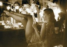 Showgirl backstage. Unknown source.