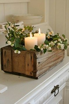 Simple and rustic centerpiece. Wood box, greenery, and candles. Lovely for a shower, wedding, or dinner party.