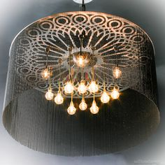 NGOMA DRUM   A cylindrical drum shaped chandelier with a support frame inspired by Venetian wrought iron design.  #willowlamp #lighting #Africa