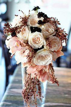 9. Floral arrangement(s) #modcloth #wedding dusty rose and pale pink colors.