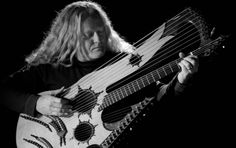 Keith Medley, inventor of the 27 string guitar. A hauntingly beautiful piece of composition. http://youtu.be/lo5mvTfYSQY
