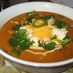 """0Recipe by: KMHIX""""This is a copy of a favorite served at a local restaurant. My family loves it! Serve soup in bowls garnished with shredded Cheddar or Jack cheese and crumbed tortilla …"""
