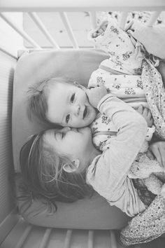 a kiss, baby and family photos, sibling photos, kid photos, sibling pictures