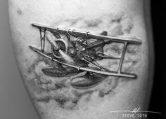 Black and grey plane tattoo