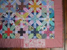 hopfaldera's x and + quilt.    love that border and how she quilted it.   i may have to quilt mine similarly.