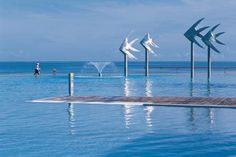 Recessed boardwalks on the sea edge of this lagoon create the impression people are walking on water