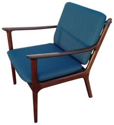 For your consideration, an iconic danish modern mahogany lounge chair; the model PJ112 designed by Ole Wanscher and manufactured by P. Jeppesen, st. Heddinge, Denmark, in 1951. This chair is referenced in the Danish Design museum as # RP02694. Recently imported. New foam and new upholstery in dark teal. Fantastic vintage condition.