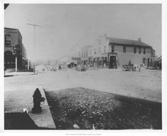 Kansas City: Westport Rd and Pennsylvania - Boone's Trading Post. Seen here occupied by Meriwether and Son. Now occupied by Kelly's Westport Inn. [circa 1892].