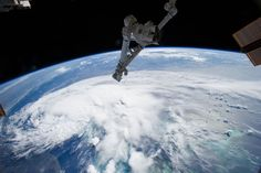 Looking out the window of the International Space Station in early July, astronauts spotted a sprawling mass of clouds. The clouds were just beginning to take shape as the first tropical storm of the 2014 season built over the Atlantic Ocean. Tropical Storm Arthur formed off southern Florida on July 1. By the morning of July 2, when this photo was taken with a wide-angle lens, the storm was moving north along the Florida coast.