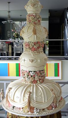 """Beautiful!!  Here we see the 60"""" tall wedding cake , with the 36 """" base board, displayed on the 24"""" unstable table. SCARRY ! We hope it made it through the night."""