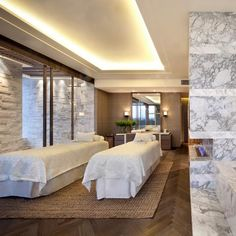 At the Hirsh Bedner Associates-designed Spa at the Grand Hyatt Shenyang, wellness is not rushed. The soothing Bianco Statuario marble and grey Lati wood treatment rooms each fea. Spa Luxe, Luxury Spa, Hba Design, Spa Lighting, Ceiling Lighting, Spa Treatment Room, Boutique Spa, Spa Interior, Spa Center