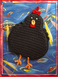 Another chicken potholder.  I love it! black crochet chicken with feet--mimic with applique and quilting