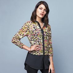 Button-front geo-printed tunic for a chic layered look with a solid black mandarin collar and button placket, the relaxed fit is designed to fall below the hip.  Featuring a high/low hem, the mid section and long sleeves are a fun print while bottom half of the shirt is sheer solid black. https://www.avon.com/product/54413/abstract-button-up-tunic-in-misses?repId=16402404
