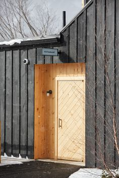 The exterior of the structure is wrapped with board-and-batten boards that have been milled locally and finished with a dark stain. It's balanced out by sections and accents made with natural pine and cedar.