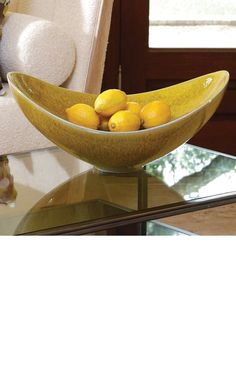 The Global Views Citron Swoop Bowl expresses its message in the language of curve and color. Nestle fruit or other display items into this citron-glazed bowl for a simmering modern statement. Yellow Home Accessories, Yellow Home Decor, Home Decor Accessories, Decorative Accessories, Yellow Bowls, Yellow Vase, Chandeliers, Extreme Makeover Home Edition, Luxury Home Decor