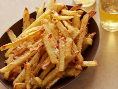 Oven-Baked Parmesan French Fries : These four-ingredient french fries add a comforting touch to any weeknight meal, for few extra calories.Wait until the fries start to brown in the oven, then sprinkle them with Parmesan and continue to bake until the cheeseis melted and caramelized.