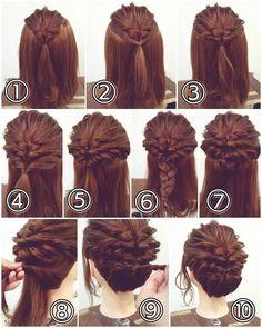 先程の投稿スタイルの作り方です! アップアレンジ ① トップを結びくるりんぱをします。少し毛束をつまみ引き出して柔らかさを出しておきます。 ② その両わきを髪をとり後ろで結びます。 ③ それをくるりんぱします。 ④ サイドの髪をロープ編みの要領で髪を拾い足しながら編んでいきます。両サイド編んだら後ろで結びます。 ⑤ それをくるりんぱします。 ⑥ できた毛束をまとめて三つ編みにします。 ⑦ その三つ編みをお団子にしてピンで留めます。 ⑧ 残った髪を耳の後ろからロープ編みの要領で下側の髪を拾い足しながら編んでいき真ん中まできたら髪は拾わずロープ編みにしてピンで留めます。 ⑨ 反対側も同じようにロープ編み込みにして毛先はロープ編みに。 ⑩ 毛先を内側に収めてピンで留めます。かたちを整えたら完成です! #横浜美容室#ヘアサロン#ヘアエステ#美容室#ヘアアレンジ#ヘアアレンジ解説#ヘアアレンジプロセス#簡単アレンジ#まとめ髪#ヘアスタイル#アップアレンジ#くるりんぱ#ロープ編み#横浜#石川町#元町#nest