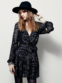Tiger Eyes Mini Dress from Free People...love this sequin wrap dress. I would style it with old Hollywood waves, black tights and some great heels