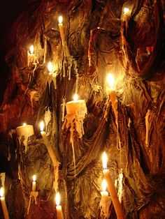 The pictured wall supposedly burned down, but it looks like they used real candles:) Would be pretty cool to recreate with flameless candles...
