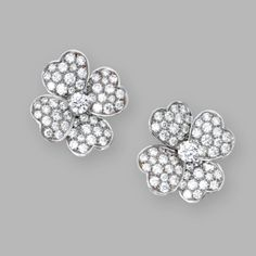 PAIR OF 18 KARAT WHITE GOLD AND DIAMOND 'COSMOS' EARCLIPS, VAN CLEEF & ARPELS, FRANCE    Designed as flowerheads set with round diamonds weighing approximately 5.70 carats, signed Van Cleef & Arpels, numbered BL 50041, French assay marks