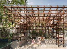 VAC-Library by Farming Architects is a large wooden climbing frame that uses solar-powered aquaponics to keep vegetables, koi carp and chickens in Hanoi. Wooden Climbing Frame, Architecture Cool, Library Architecture, Jungle Gym, Open Library, Fish Ponds, Urban Setting, Aquaponics System, Aquaponics Greenhouse