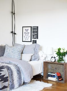 layered patterns and textures, crate bedside table and string lights in greys, black and white and wood