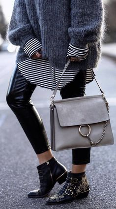 cozy fall outfit idea : oversized sweater + stripped top + bag + skinnies + boots