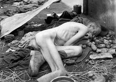 A dead prisoner lies in a train carriage near Dachau concentration camp in May of 1945. (Eric Schwab/AFP/Getty Images)