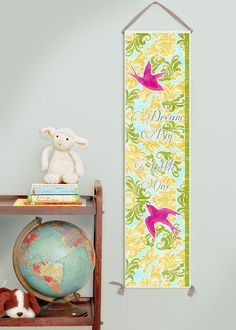 "Girl's canvas growth chart.  ""Dream Big, Little One"" with bright pink birds on a field of yellow, green, and turquoise."