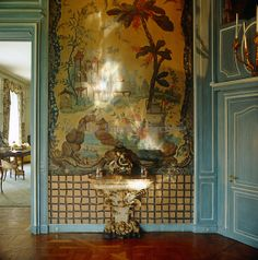 The designer Stephane Boudin was the mastermind behind the Chinoiserie-themed dining room with its elaborately painted panels