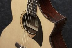 Ibanez acoustic from the AEW series.  This one has cordia back and sides.  Another wood I've never heard of.