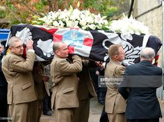The coffin of John Spencer-Churchill, 11th Duke of Marlborough leaves the church of St Mary Magdalene after his funeral on October 24, 2014 in Woodstock, England.