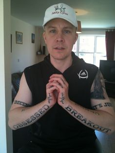 "Wanna see a picture of a guy that will never get laid? He has Miley Cyrus song titles ""Obsessed"" and ""Breakout"" on his arms, her signature on his hands, her name across his collar bone and her portrait on his arm!! Seriously dude you need professional help!! Make a scrapbook or something damn!!"