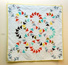 Around the Flock modern quilt. A new spin on Circle of Geese.
