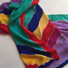 "Vintage Oscar de la Renta Scarf These vibrant colors are reminiscent of all things '80's! For all you retro girls out there, the scarf is the perfect pop of color to tie around a bag or knot around your head! 28"" square. Oscar de la Renta Accessories Scarves & Wraps"